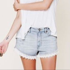 Free people light wash lace trim shorts